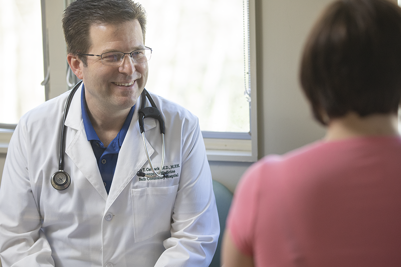 doctor addressing a patient